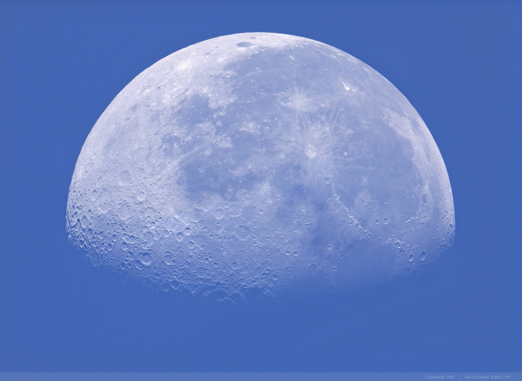 An image of the waning gibbous moon in the morning sky, captured while